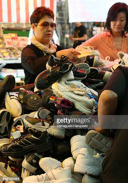 Customers browse a shoe store at Ameyoko market in Tokyo Japan Sep 2013 Ameyoko is a bustling outdoor marketplace and Tokyo's most busiest shopping...