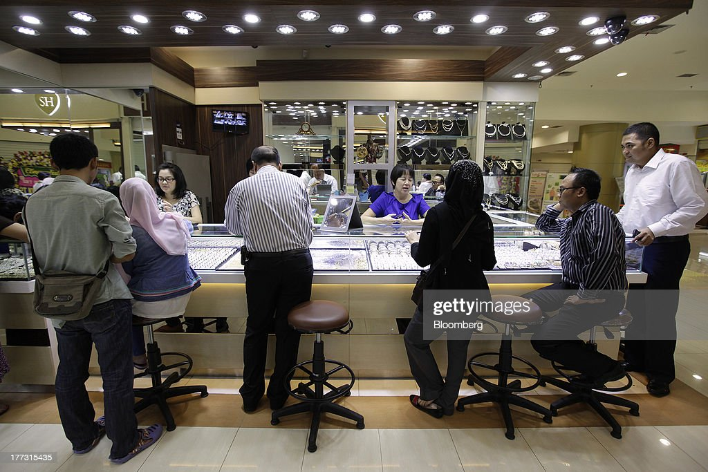 Customers browse at a jewelry store in Jakarta, Indonesia, on Thursday, Aug. 22, 2013. Gold jewelry demand in Indonesia is set to expand to a four-year high as consumers in Southeast Asia's biggest buyer join India to China in increasing purchases as prices slump and the middle class expands. Photographer: Dimas Ardian/Bloomberg via Getty Images