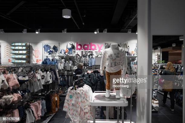 Customers browse baby clothes inside a Hema BV store in Tilburg Netherlands on Wednesday Oct 4 2017 Privateequity firm Lion Capital LLP which bought...
