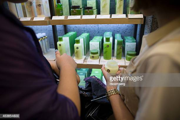 Customers browse beauty products at Amorepacific Corp's Innisfree store in the Causeway Bay district of Hong Kong China on Wednesday Aug 20 2014...