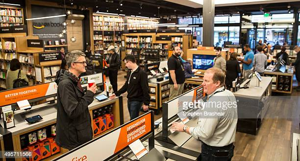 Customers browse books and other Amazon products at the newlyopened Amazon Books store on November 4 2015 in Seattle Washington The online retailer...