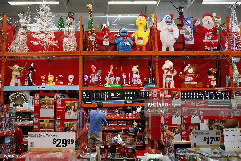 Customers browse christmas decorations while shopping at a for Home depot christmas decorations 2013