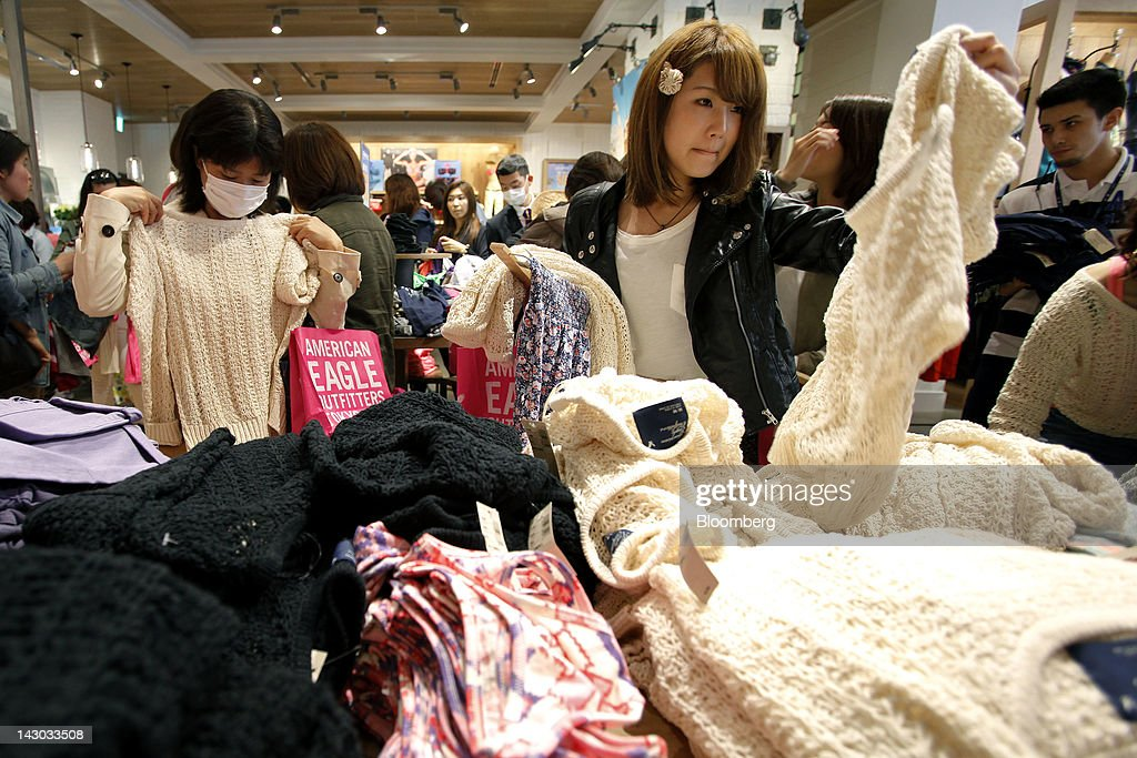 Customers browse clothes at an American Eagle Outfitters Inc. store in Tokyo, Japan, on Wednesday, April 18, 2012. American Eagle Outfitters Inc., a retailer of men's and women's casual apparel, opened its first store in Japan inside the Tokyu Plaza Omotesando Harajuku retail complex in the Omotesando district of Tokyo today. Photographer: Kiyoshi Ota/Bloomberg via Getty Images