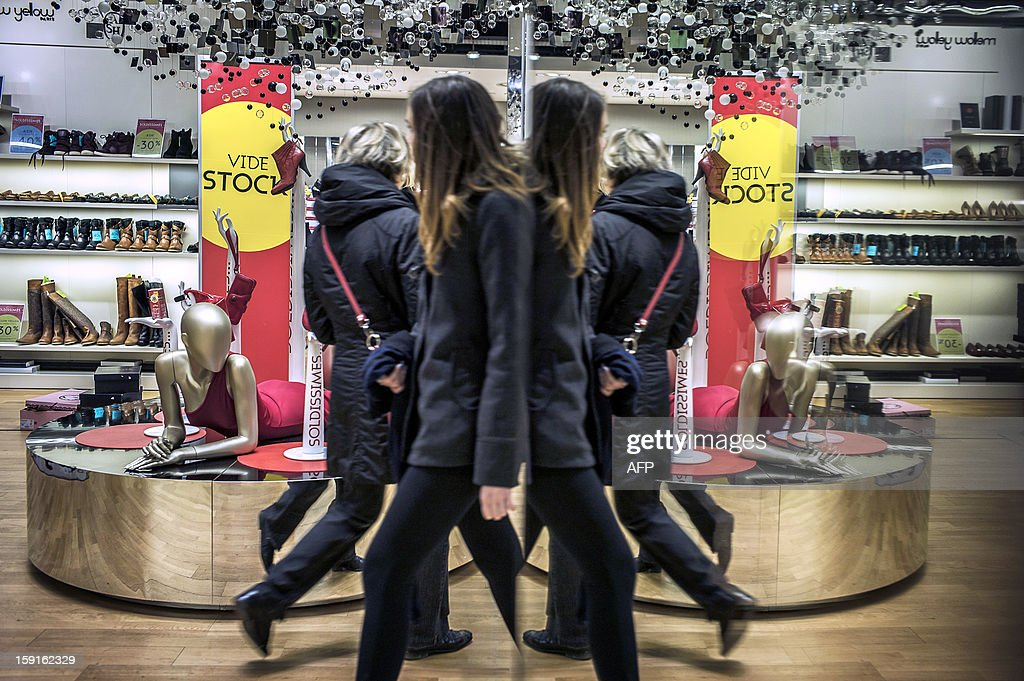 Customers browse clothes at the Galeries Lafayette department store in Lyon, on January 9, 2013, during the official start of winter sales.