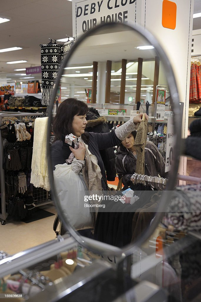 Customers browse clothes in an Aeon Co. shopping center in Tokyo, Japan, on Friday, Nov. 9, 2012. Aeon Co. is Japan's largest supermarket operator. Photographer: Akio Kon/Bloomberg via Getty Images