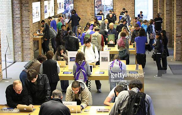 Customers browse computer products at Apple Inc's Covent Garden store in London UK on Friday Aug 26 2011 Without Steve Jobs Apple Inc may start to...