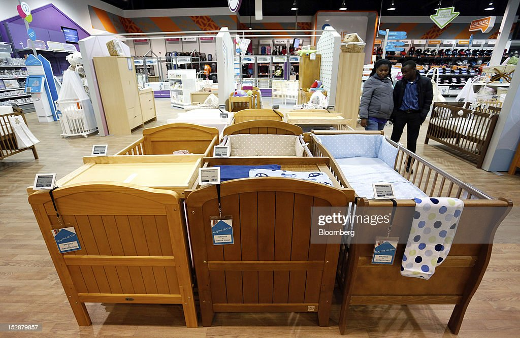 Customers browse cots in the nursery furniture section of a Kiddicare Ltd. store, operated by WM Morrison Supermarkets Plc, in Nottingham, U.K., on Wednesday, Sept. 26, 2012. An index of U.K. retail sales rose for the first time in three months in September and stores expect demand to increase further next month, the Confederation of British Industry said. Photographer: Paul Thomas/Bloomberg via Getty Images