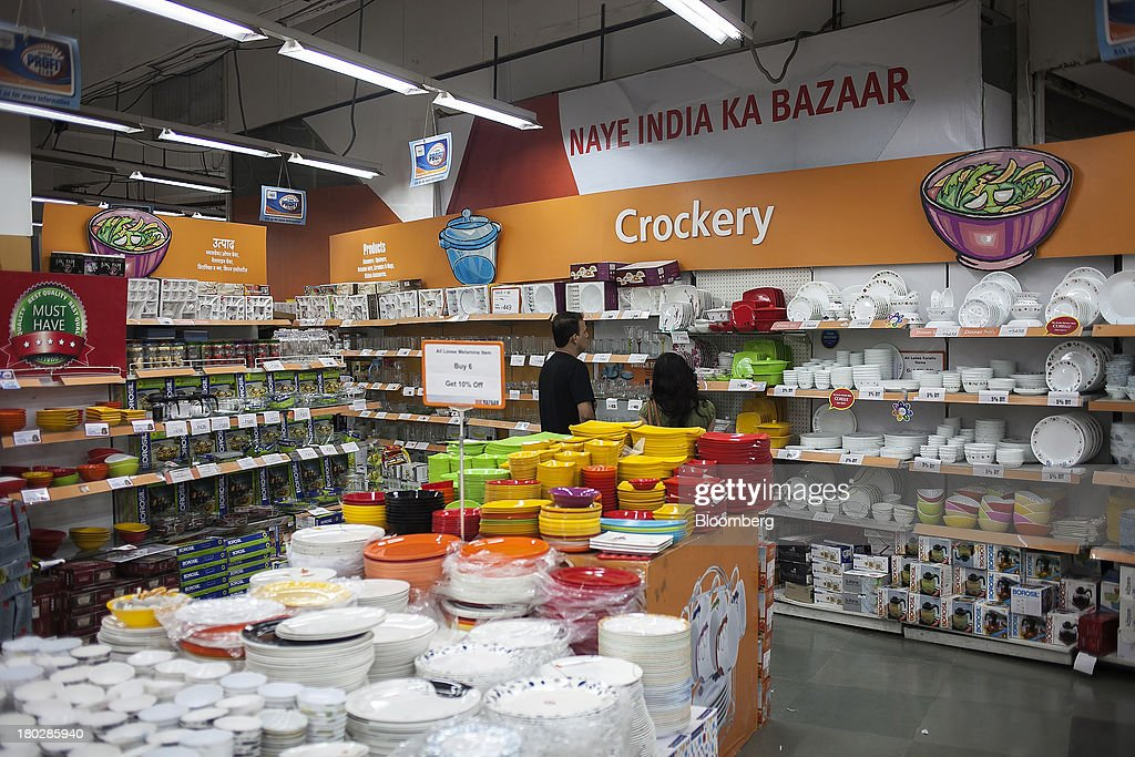 Customers browse crockery and tableware displayed for sale in the Big Bazaar Hypermarket store in Noida, India, on Monday, Sept. 9, 2013. Indias rupee fell, snapping the biggest four-day surge in 40 years, on concern slowing growth will deter inflows needed to reduce the current-account deficit. Photographer: Prashanth Vishwanathan/Bloomberg via Getty Images