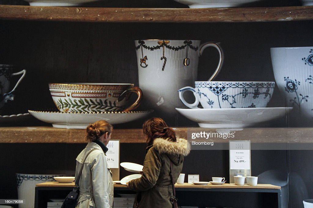 Customers browse Danish porcelain on display inside the Royal Copenhagen store on Storget street in Copenhagen, Denmark, on Friday, Feb. 1, 2013. Danish regional banks are struggling to emerge from a burst property bubble that's forced the government resolution agency to take over a dozen lenders after losses on commercial and agricultural loans wiped out capital. Photographer: Freya Ingrid Morales/Bloomberg via Getty Images
