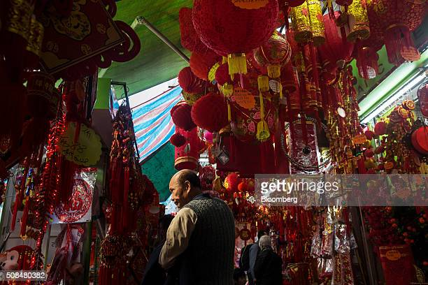 Customers browse decorations on sale for Lunar New Year at market stalls in the Sham Shui Po district of Hong Kong China on Thursday Feb 4 2016 The...