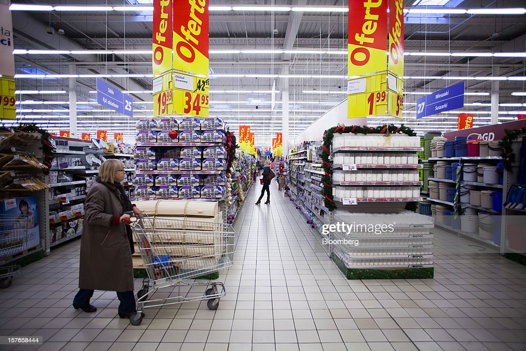 Customers browse discounted goods on offer inside a Real supermarket in Wroclaw, Poland, on Wednesday, Dec. 5, 2012. Metro AG, Germany's biggest retailer, agreed to sell its Real grocery stores in eastern Europe to Groupe Auchan SA of France for 1.1 billion euros ($1.4 billion) in Chief Executive Officer Olaf Koch's first big deal since taking the helm. Photographer: Bartek Sadowski/Bloomberg via Getty Images
