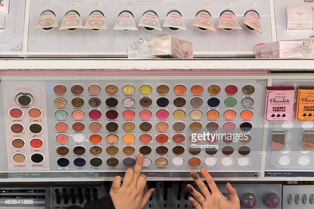 Customers browse eyeshadow pallets at an Amorepacific Corp Etude House store in the Myeongdong shopping district in Seoul South Korea on Monday Feb...