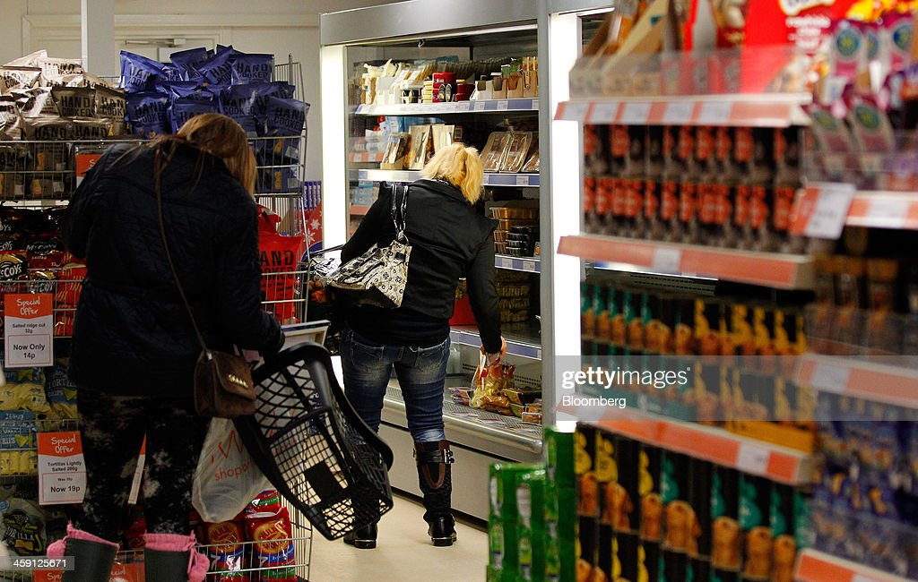 Customers browse food displayed for sale inside the Community shop, a supermarket for low-income families, in Goldthorpe, U.K., on Monday, Dec. 23, 2013. Company Shop Ltd. created the Community shop for people in, or bordering on, food poverty, selling surplus goods from major retailers at discounted prices. Photographer: Paul Thomas/Bloomberg via Getty Images