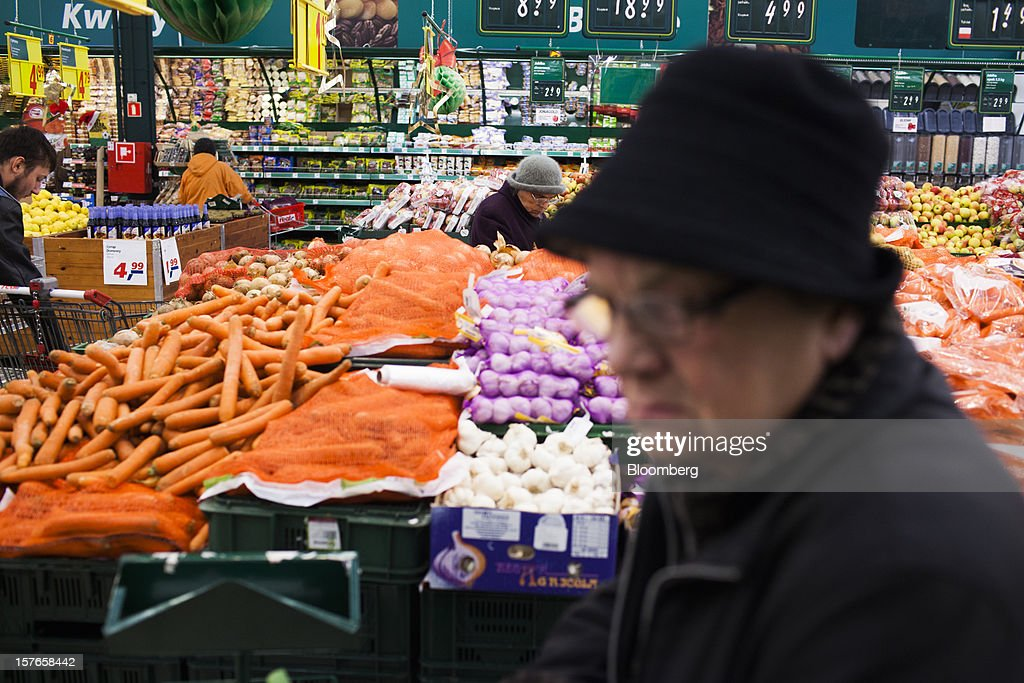 Customers browse fresh groceries inside a Real supermarket in Wroclaw, Poland, on Wednesday, Dec. 5, 2012. Metro AG, Germany's biggest retailer, agreed to sell its Real grocery stores in eastern Europe to Groupe Auchan SA of France for 1.1 billion euros ($1.4 billion) in Chief Executive Officer Olaf Koch's first big deal since taking the helm. Photographer: Bartek Sadowski/Bloomberg via Getty Images