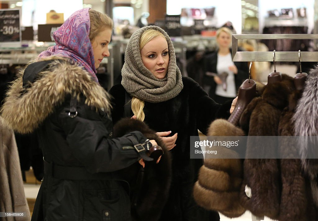 Customers browse fur fashion goods on display at the World of Fur and Leather store in Moscow, Russia, on Sunday, Dec. 16, 2012. Russia's government should introduce a tax on luxury consumption in first half of 2013, President Vladimir Putin said in state-of-the-nation address in Moscow. Photographer: Andrey Rudakov/Bloomberg via Getty Images