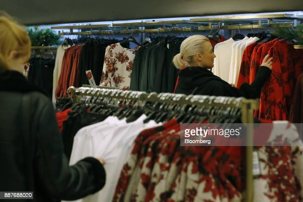 Customers browse garments in the womenswear section inside a branch of Marks Spencer Group Plc in London UK on Tuesday Dec 5 2017 Brexit uncertainty...