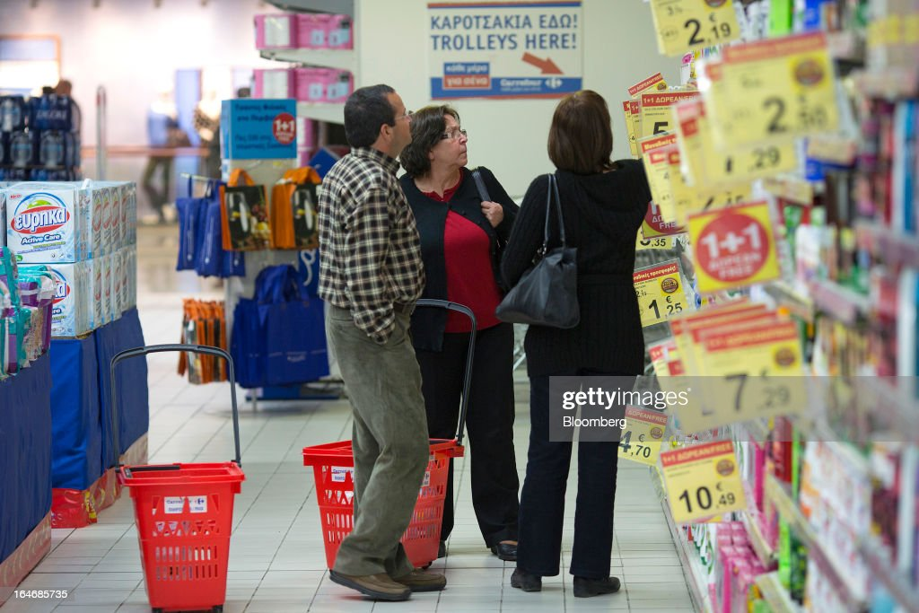 Customers browse good on display inside a Carrefour SA supermarket at the Mall of Cyprus in Nicosia, Cyprus, on Tuesday, March 26, 2013. Controls on capital movements to prevent money from draining out of the banking system -- allowed in exceptional circumstances under European Union law -- will remain for 'a matter of weeks,' Cypriot Finance Minister Michael Sarris said. Photographer: Simon Dawson/Bloomberg via Getty Images