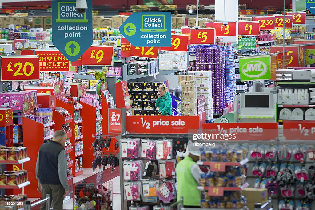 Customers browse goods displayed on aisles inside an Asda supermarket, the U.K. retail arm of Wal-Mart Stores Inc., in Watford, U.K., on Thursday, Oct. 17, 2013. U.K. retail sales rose more than economists forecast in September as an increase in furniture demand led a rebound from a slump the previous month. Photographer: Simon Dawson/Bloomberg via Getty Images