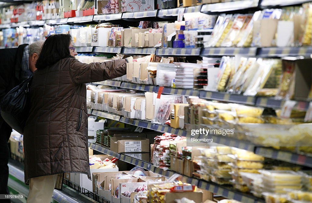 Customers browse goods in the chilled section at a OnePrice supermarket, operated by Gruppo BSE, in Monterotondo, Italy, on Wednesday, Nov. 28, 2012. Italy needs to uphold Prime Minister Mario Monti's pledge to shore up public finances in order to enjoy investor confidence even after elections due by April, the Organization for Economic Cooperation and Development said in its latest Economic Outlook report this week. Photographer: Alessia Pierdomenico/Bloomberg via Getty Images