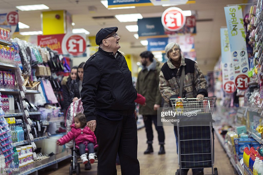 Customers browse goods inside a Poundland discount store, operated by Poundland Group Plc in London, U.K., on Friday, March 7, 2014. Poundland Group Plc has demand for all the shares it is selling in an initial public offering that will value the U.K. discount retailer at as much as 750 million pounds ($1.3 billion), according to terms of the deal. Photographer: Simon Dawson/Bloomberg via Getty Images