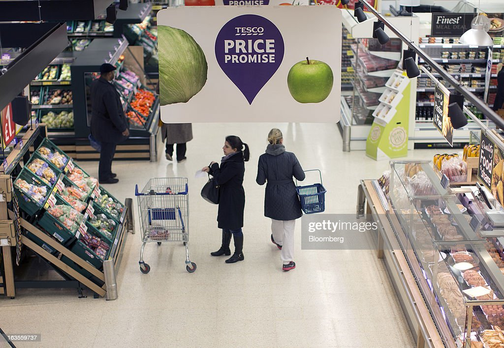 Customers browse goods inside a Tesco Plc supermarket in the borough of Kensington in London, U.K., on Tuesday, March 12, 2013. Tesco Plc, the U.K.'s largest grocer launched a 'Price Promise', its latest initiative offering to match the price of customers' purchases to that of it's rivals, including Wal-Mart Stores Inc.'s ASDA. Photographer: Simon Dawson/Bloomberg via Getty Images