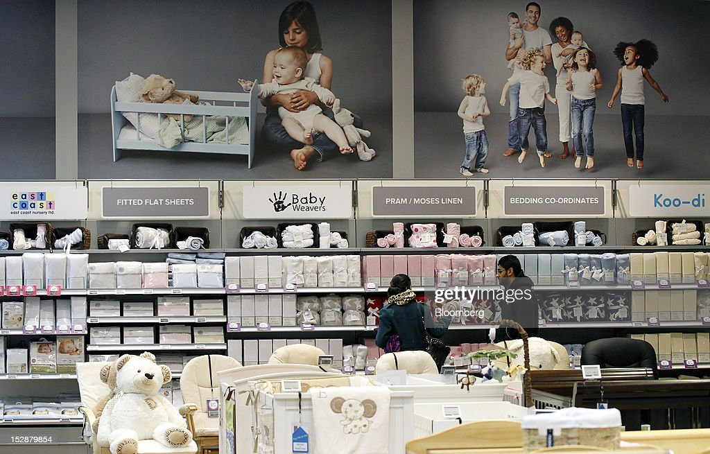 Customers browse goods on display at a Kiddicare Ltd. store, operated by WM Morrison Supermarkets Plc, in Nottingham, U.K., on Wednesday, Sept. 26, 2012. An index of U.K. retail sales rose for the first time in three months in September and stores expect demand to increase further next month, the Confederation of British Industry said. Photographer: Paul Thomas/Bloomberg via Getty Images
