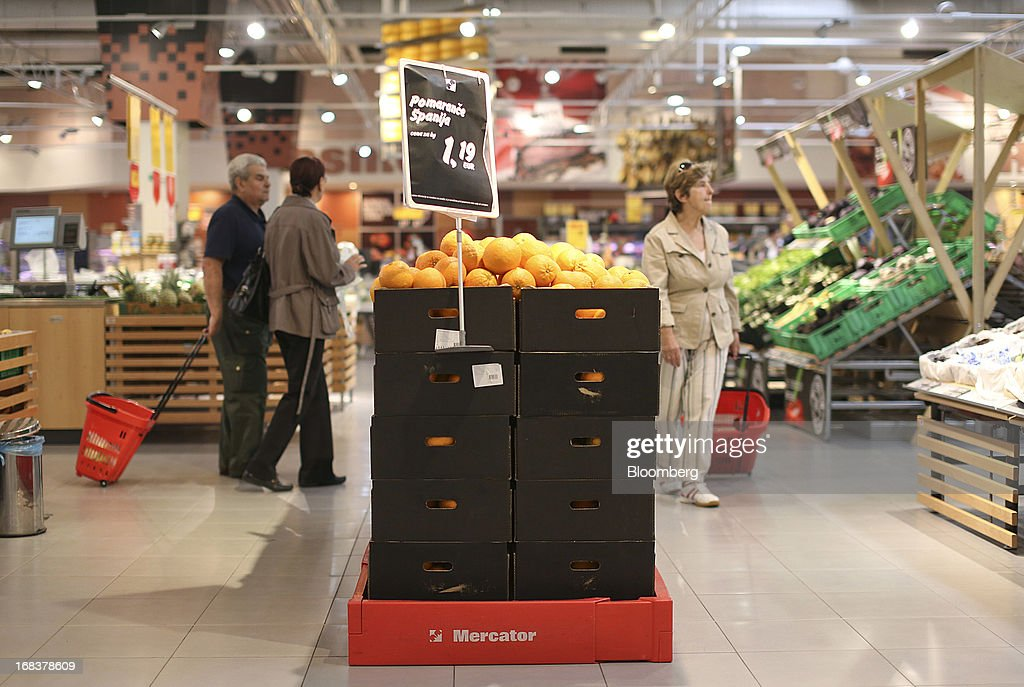 Customers browse goods on display in the grocery section of a Mercator Poslovni Sistem d.d. supermarket in Ljubljana, Slovenia, on Wednesday, May 8, 2013. In January Mercator reported its first full-year loss in fifteen years as the largest supermarket chain's sales in the Balkans last year suffered during the recession. Photographer: Chris Ratcliffe/Bloomberg via Getty Images
