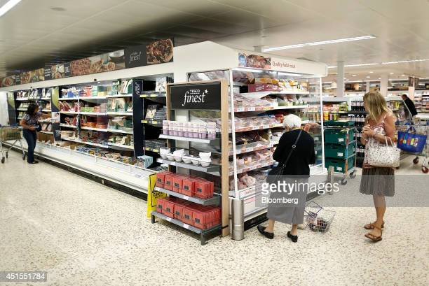 Customers browse halal meat right displayed for sale in a chiller cabinet inside a Tesco Extra Supermarket operated by Tesco Plc in London UK on...