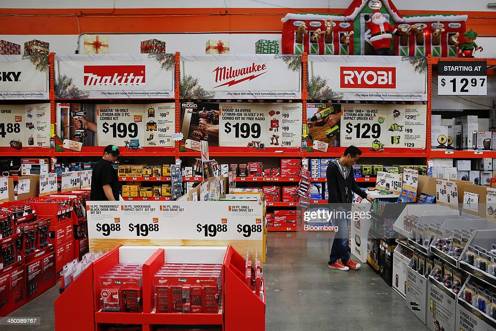 Customers browse hardware tools while shopping at a Home