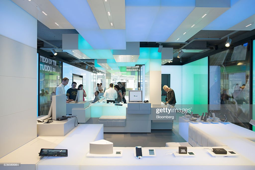 Customers browse inside a Royal KPN NV mobile phone store in Nijmegen, Netherlands, on Friday, May 6, 2016. Carlos Slim's America Movil SAB is considering the sale of its minority stake in Dutch phone company KPN, less than three years after the Mexican billionaire's failed takeover attempt, according to people with knowledge of the matter. Photographer: Jasper Juinen/Bloomberg via Getty Images