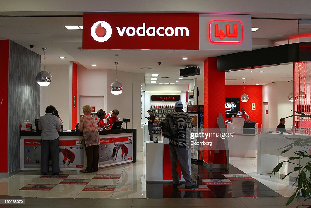 Customers browse inside a Vodacom store inside Vodaworld the headquarters of Vodacom Group Ltd Vodafone's biggest African business in Johannesburg...