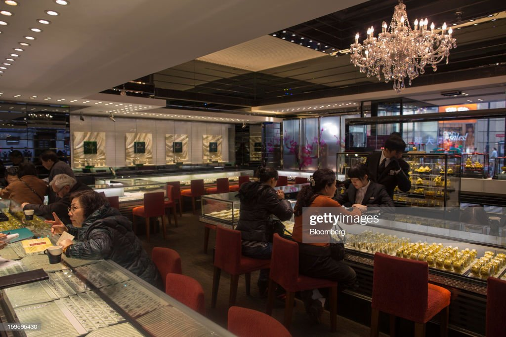 Customers browse jewelry in a Chow Tai Fook Jewellery Group Ltd. store in the Central district of Hong Kong, China, on Wednesday, Jan. 16, 2013. Chow Tai Fook Jewellery., the world's biggest jeweler by market value, posted an 8 percent drop in third-quarter same-store sales as Chinese shoppers curbed spending amid a slower economy. Photographer: Jerome Favre/Bloomberg via Getty Images
