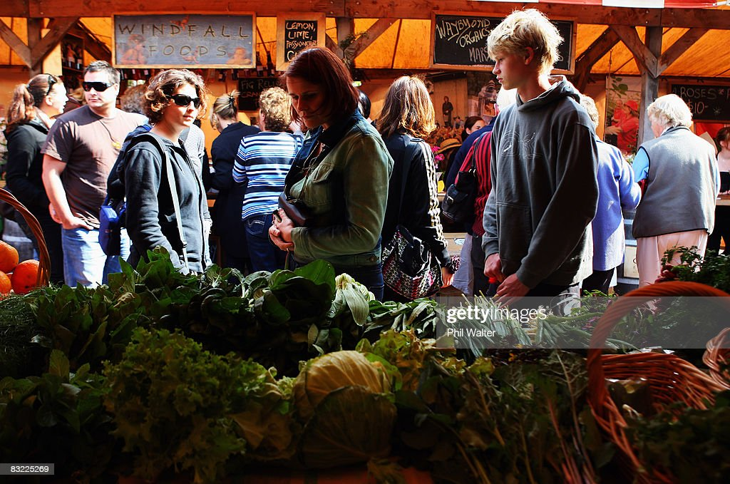 Customers browse locally grown vegatables for sale at the Matakana Famers Market in Matakana October 11, 2008 near Auckland, New Zealand. Farmers markets in New Zealand are rapidly growing in popularity as people seek more healthy, fresh and nutritious alternatives to supermarket food.