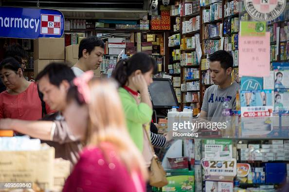 Customers browse merchandise at a pharmacy in the Sheung Shui district near the border with mainland China in Hong Kong China on Monday April 13 2015...