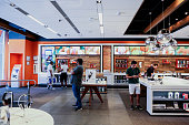 Customers browse merchandise inside an ATT Inc store in New York US on Friday July 22 2016 ATT posted secondquarter profit that was in line with...