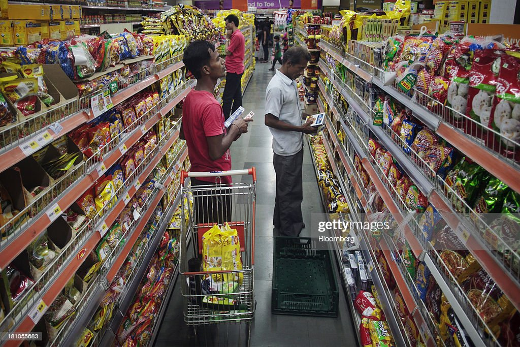 Customers browse packaged foods at the Big Bazaar Hypermarket store in Noida, India, on Monday, Sept. 9, 2013. Indias rupee fell, snapping the biggest four-day surge in 40 years, on concern slowing growth will deter inflows needed to reduce the current-account deficit. Photographer: Prashanth Vishwanathan/Bloomberg via Getty Images