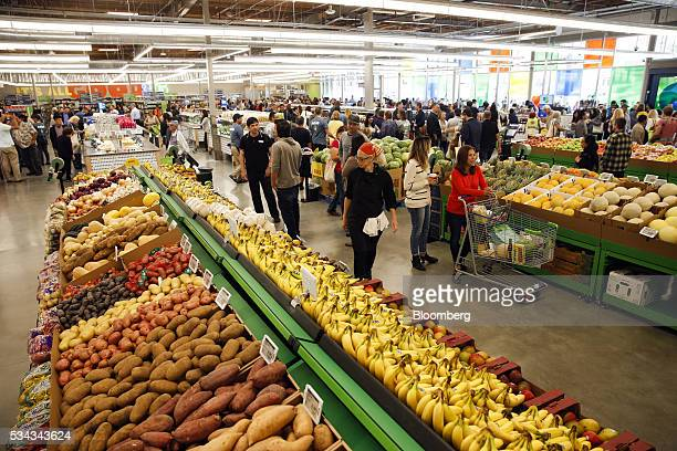 Customers browse produce for sale while shopping on the opening day of the 365 by Whole Foods Market store in the Silver Lake neighborhood of Los...