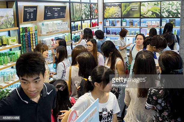 Customers browse products at Amorepacific Corp's Innisfree store in the Causeway Bay district of Hong Kong China on Wednesday Aug 20 2014 Sales in...