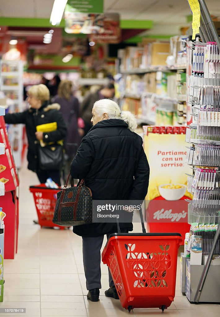 Customers browse products inside a OnePrice supermarket, operated by Gruppo BSE, in Monterotondo, Italy, on Wednesday, Nov. 28, 2012. Italy needs to uphold Prime Minister Mario Monti's pledge to shore up public finances in order to enjoy investor confidence even after elections due by April, the Organization for Economic Cooperation and Development said in its latest Economic Outlook report this week. Photographer: Alessia Pierdomenico/Bloomberg via Getty Images