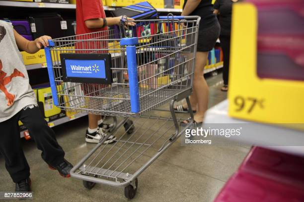 Customers browse school supplies displayed for sale at a WalMart Stores Inc location in Burbank California US on Tuesday Aug 8 2017 WalMart Stores is...