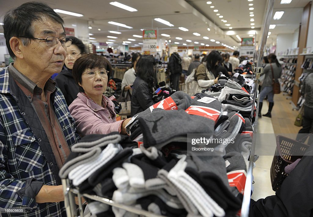 Customers browse socks in an Aeon Co. shopping center in Tokyo, Japan, on Friday, Nov. 9, 2012. Aeon Co. is Japan's largest supermarket operator. Photographer: Akio Kon/Bloomberg via Getty Images