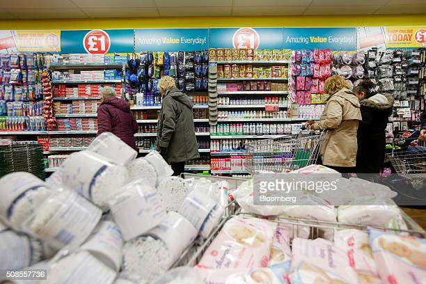 Customers browse toiletries for sale at a Poundland Group Plc store in Leigh UK on Thursday Feb 4 2016 UK like for like sales at midmarket retailers...