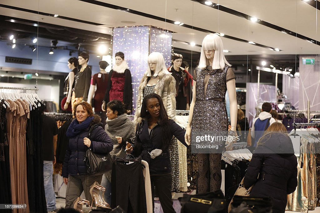Customers browse women's clothes inside a Topshop store, owned by Arcadia Group Ltd., on Oxford Street in London, U.K., on Thursday, Dec. 6, 2012. Philip Green, the billionaire owner of the Arcadia fashion business, sold a 25 percent stake in the Topshop and Topman retail chains to Leonard Green & Partners LP, the co-owner of the J Crew fashion brand, in a deal valuing the businesses at 2 billion pounds ($3.2 billion). Photographer: Simon Dawson/Bloomberg via Getty Images