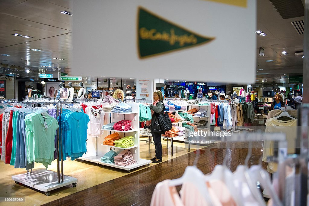 Customers browse women's clothing for sale inside an El Corte Ingles SA department store in Barcelona, Spain, on Thursday, May 30, 2013. Spain's recession eased in the first quarter as domestic demand stabilized while exports, which the government says will drive the recovery of the euro-area's fourth-largest economy, fell at the fastest pace in a year. Photographer: David Ramos/Bloomberg via Getty Images