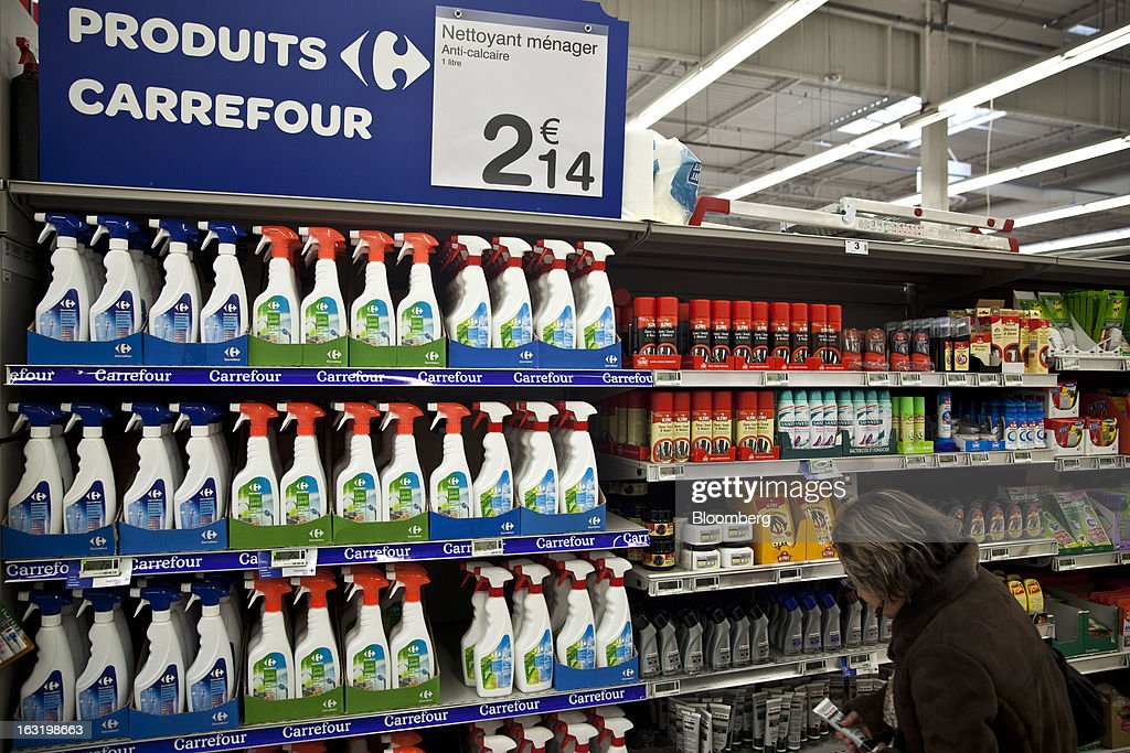 A customers browses for products near a display of Carrefour-branded household cleaning products inside a Carrefour SA supermarket in Portet sur Garonne, near Toulouse, France, on Tuesday, March 5, 2013. Carrefour's stock has risen 47 percent since Georges Plassat's arrival as chief executive officer, partially offsetting a 71 percent decline in the preceding five years. Photographer: Balint Porneczi/Bloomberg via Getty Images