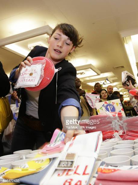 Customers browses through an exclusive range of MS products priced at just one penny to mark the store's 125th Birthday celebrations with the opening...