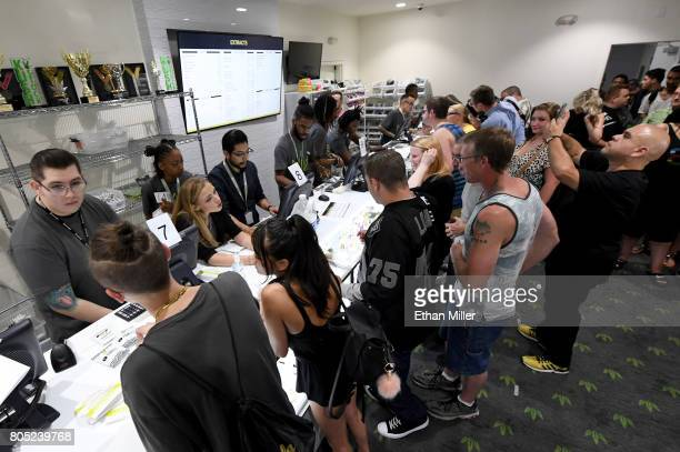 Customers buy cannabis products at Essence Vegas Cannabis Dispensary after the start of recreational marijuana sales began on July 1 2017 in Las...