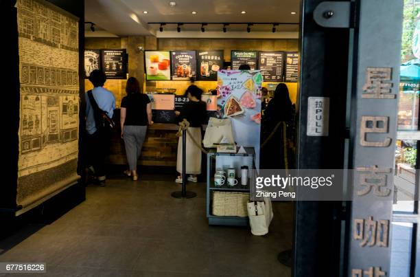 Customers buy coffee in a Starbucks coffee shop Since June 1st 2017 the fulltime employees of Starbucks in Chinese market who have worked for two...