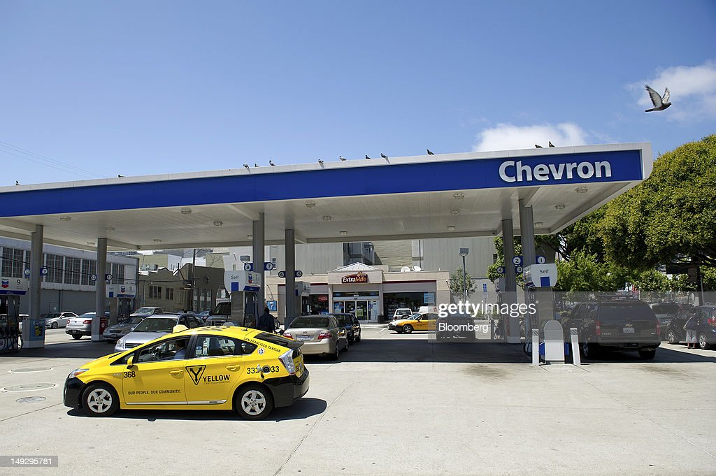 Customers buy fuel at a Chevron Corp. gasoline station in San Francisco, California, U.S., on Wednesday, July 25, 2012. Chevron is expected to release earnings data on July 27. Photographer: David Paul Morris/Bloomberg via Getty Images