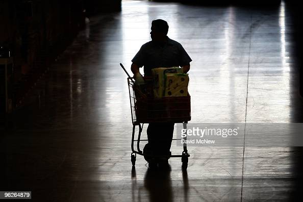 Customers buy goods at a Home Depot home improvement store on January 29 2010 in Burbank California The Commerce Department today reports...